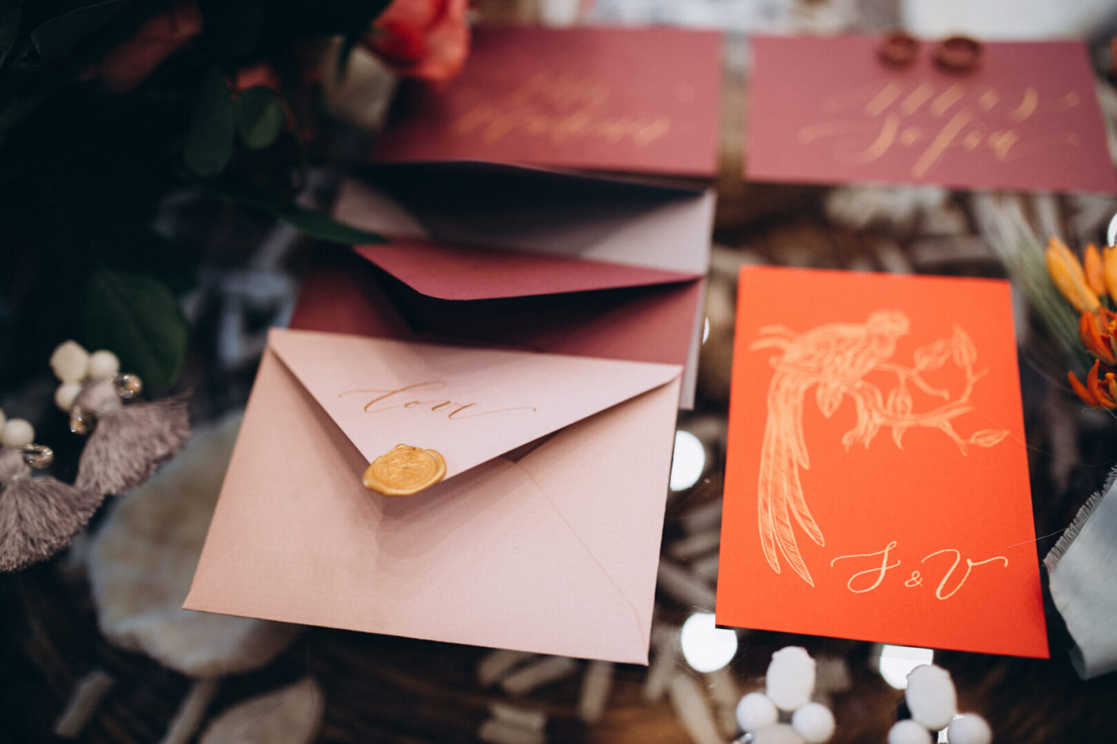A wedding concept. Invitation and items, Different colored paper envelopes on the table, background.